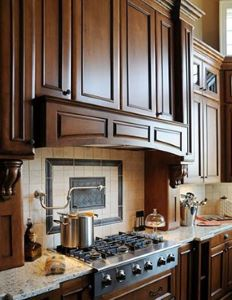 A remodeled kitchen with traditional wood hood