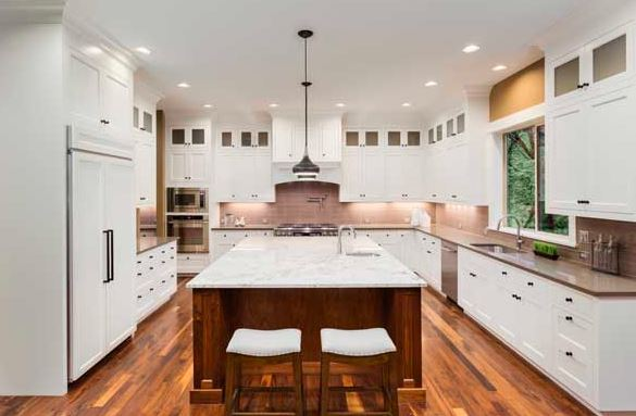 In U-shaped kitchen design there are three walls of continuous countertops and appliances