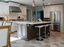 In transitional kitchen design the island can be a different finish than the perimeter cabinets