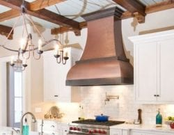 Remodeled kitchen with copper chimney hood