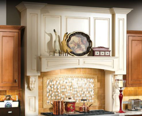 Kitchen remodel featuring wood hearth hood with corbels and moldings