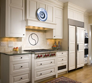 This remodeled kitchen features a box style mantel hood