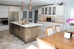 The island in a Transitional kitchen design is a good place to use rustic wood