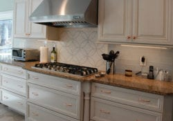 Transitional kitchen design includes a geometric pattern backsplash