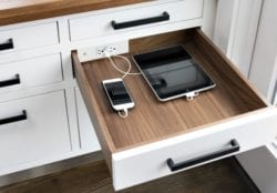 docking drawer charges phones out of sight