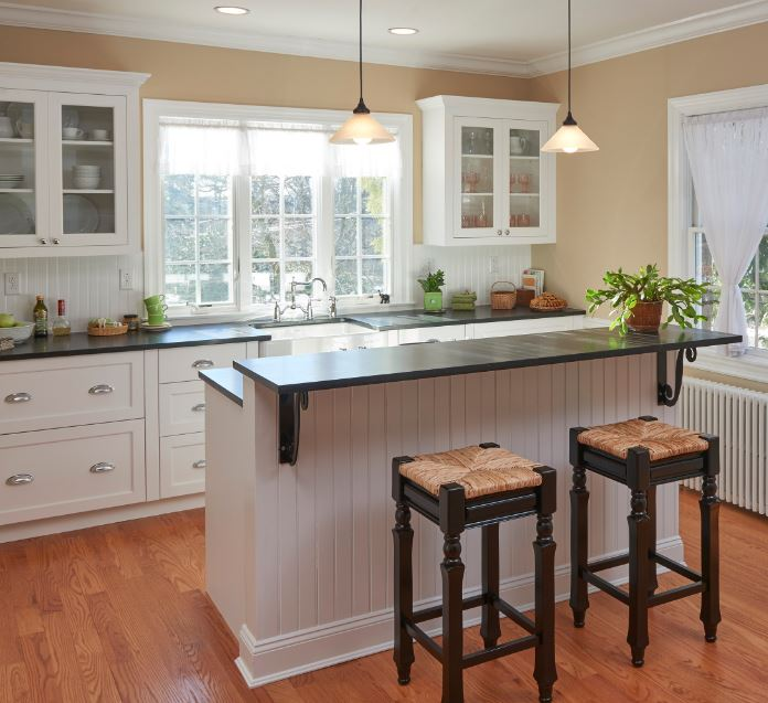 Include a two tiered island in your kitchen design if you are a messy cook