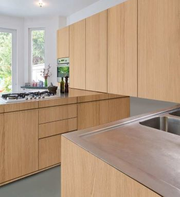 A new contemporary kitchen with sequential matched veneer doors